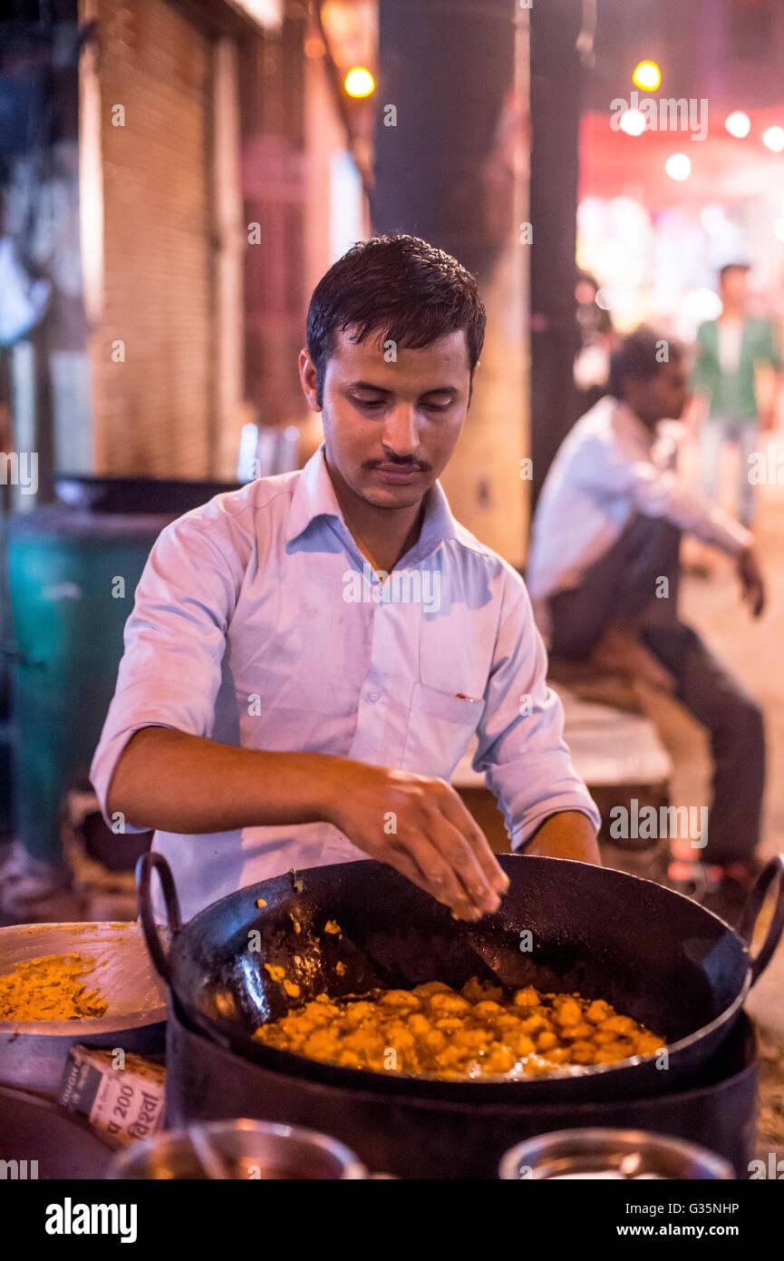 A street vendor in Delhi selling battered food India.  Credit: Euan Cherry - Stock Image