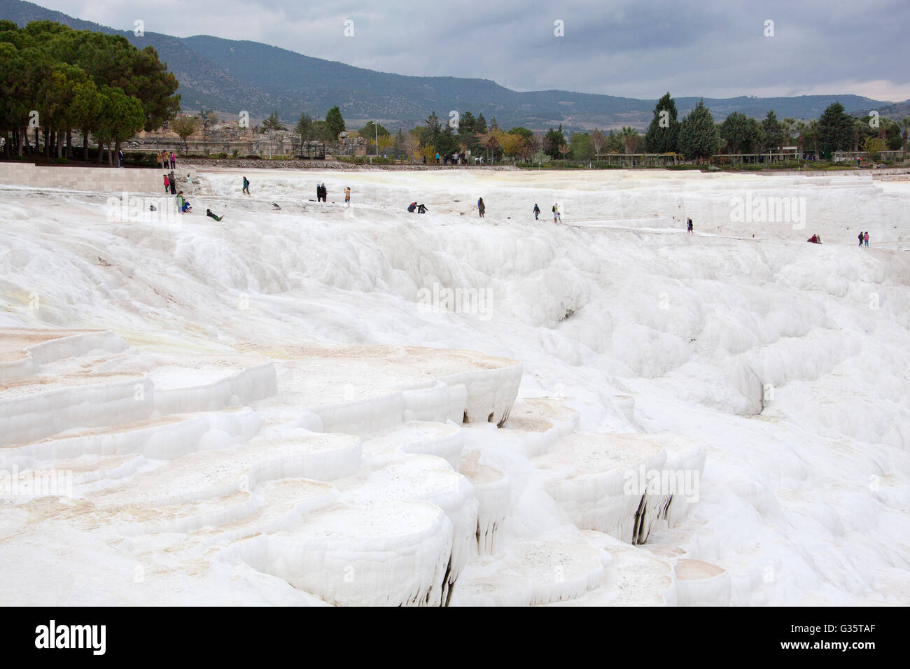 White terraces of carbonate minerals left by flowing water in Pamukkale, the World Heritage Site in Turkey. - Stock Image