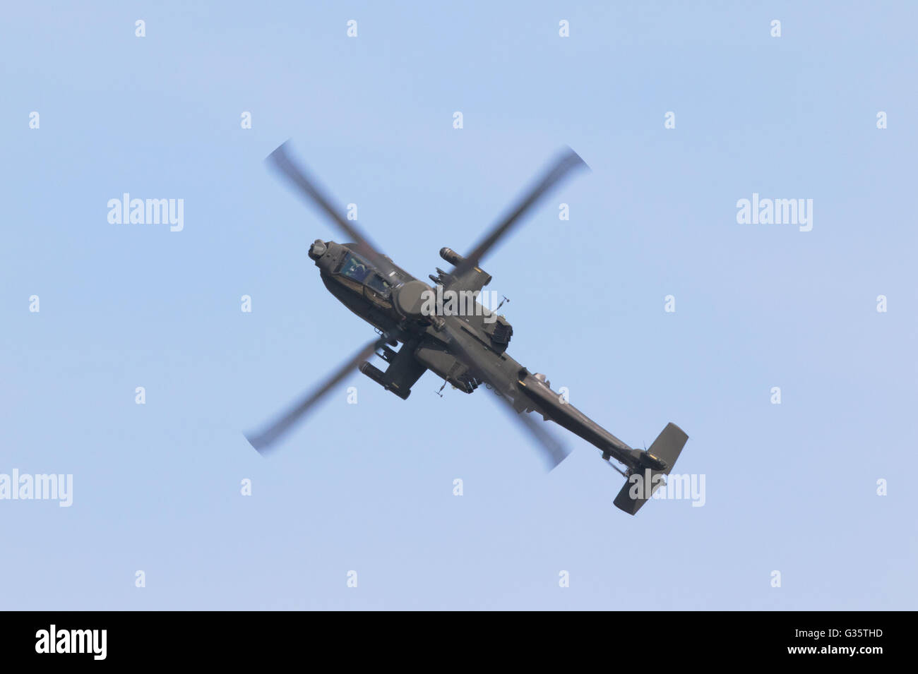 An AgustaWestland Apache AH Mk 1 helicopter in flight seen from above, Duxford airport, UK - Stock Image