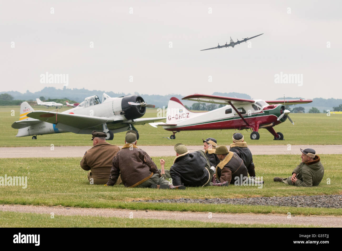 Scene at the Duxford American airshow - airmen in uniform and WW2 planes, Duxford Imperial War Museum, UK - Stock Image