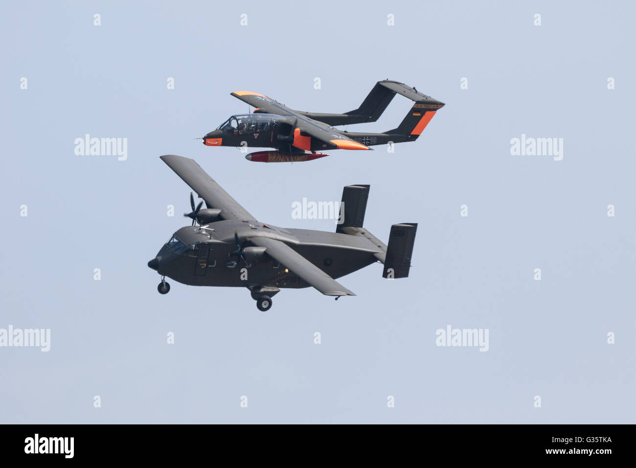 A Short SC-7 Skyvan and a North American OV-10 Bronco plane flying at Duxford American airshow, Duxford UK - Stock Image