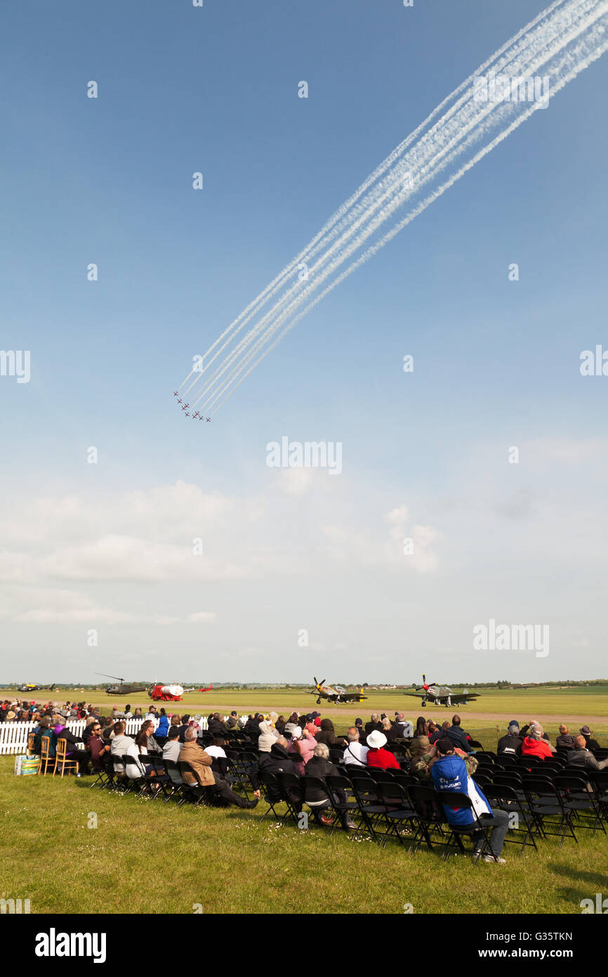 People watching the RAF Red Arrows display, Duxford Airshow, Imperial War Museum, Duxford Cambridgeshire UK - Stock Image