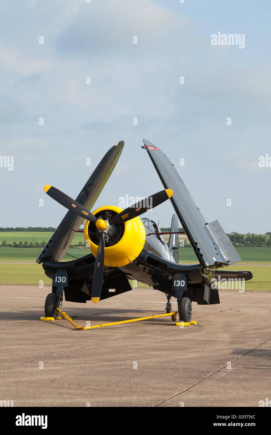 A Goodyear FG-1D Corsair plane with wings folded, on the ground at Duxford imperial War Museum, UK - Stock Image