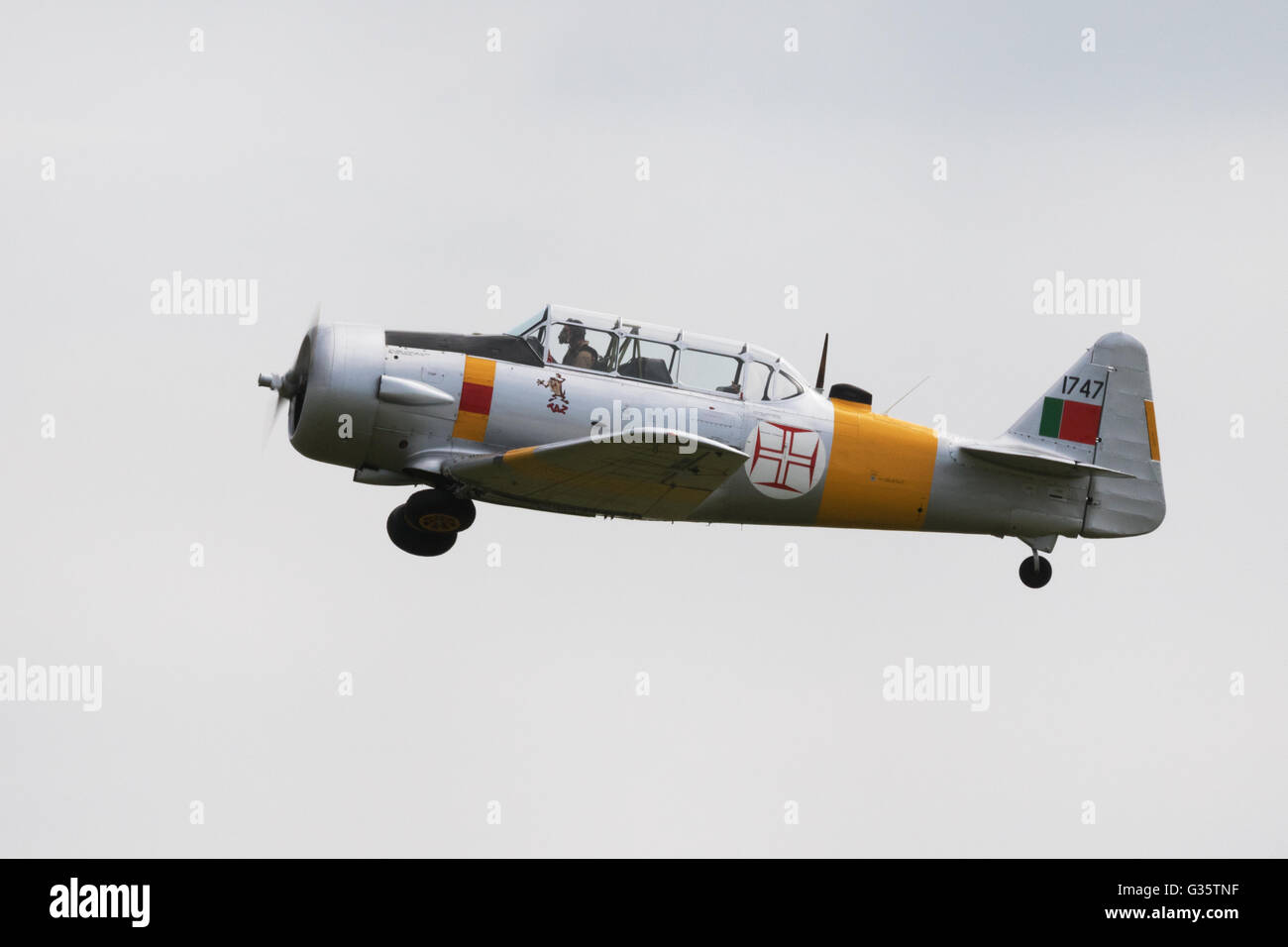 North American Harvard plane in flight, Duxford Imperial War Museum Airport, Cambridge UK - Stock Image