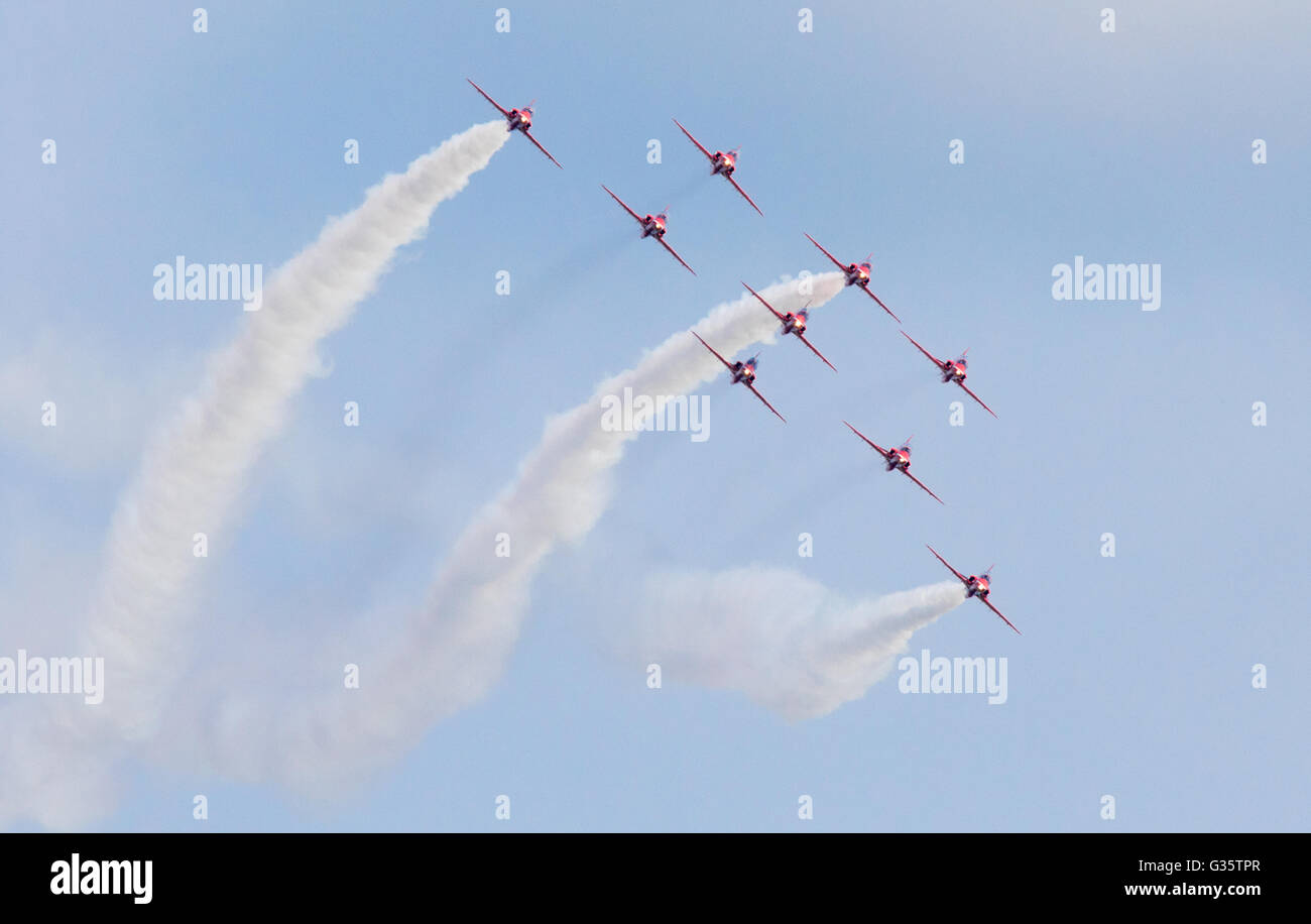 The red arrows RAF aerobatic team flying towards the camera, Duxford American Airshow, Duxford UK - Stock Image