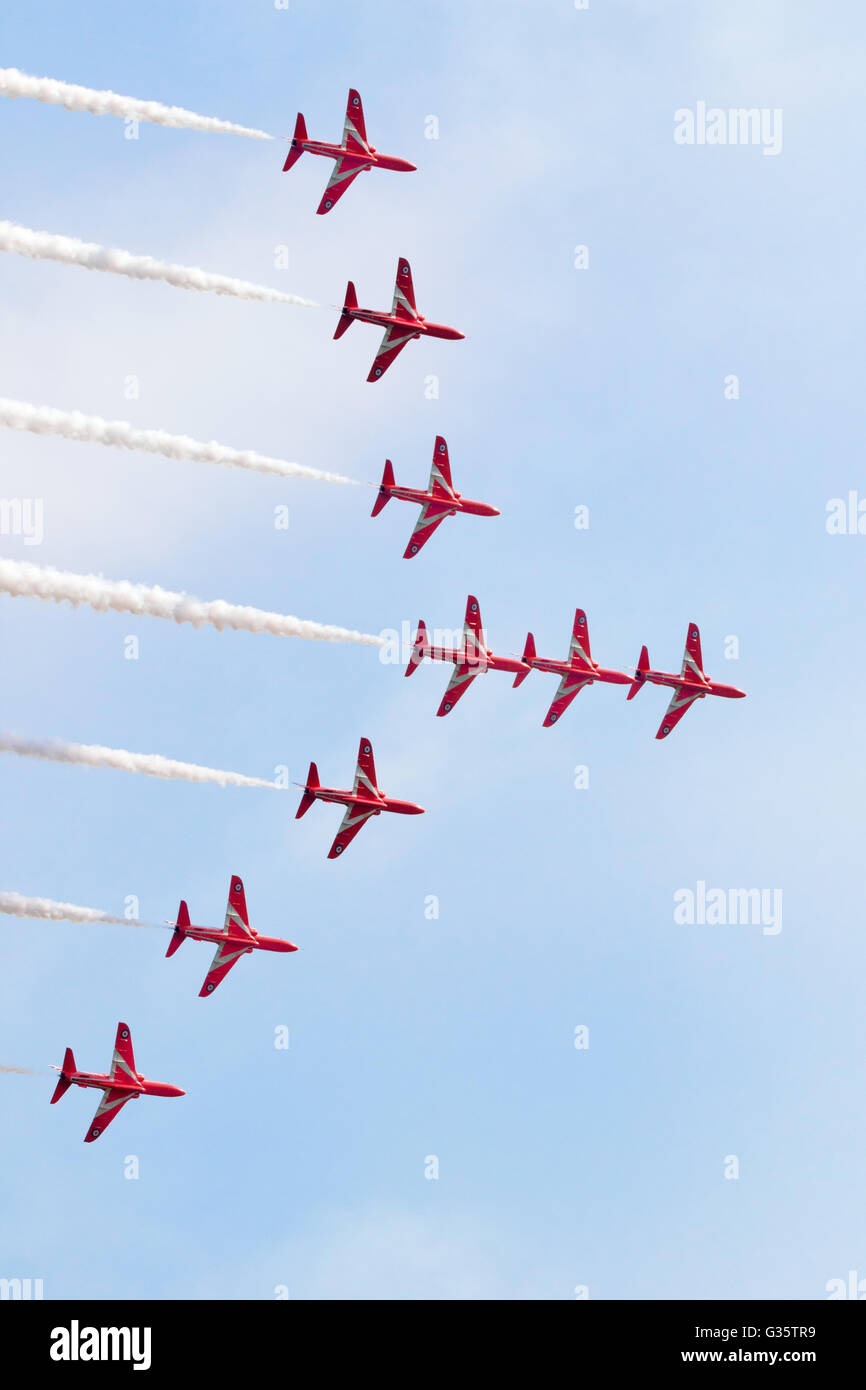 The nine members of the RAF Red Arrows aerobatics team performing at Duxford AIrshow, Duxford UK - Stock Image