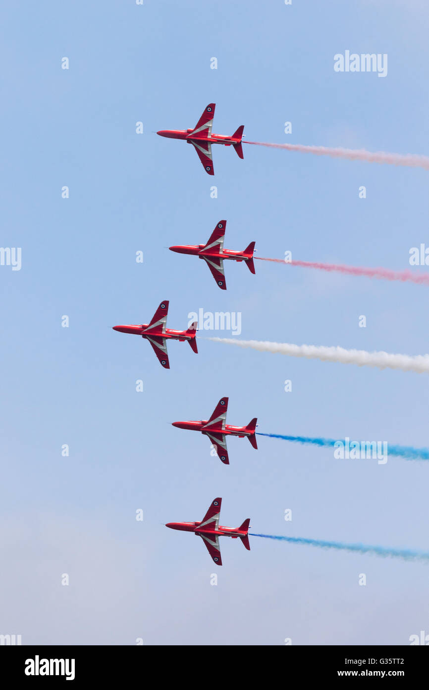 Five members of the RAF Red Arrows aerobatic display team flying in  formation with smoke 4eafe94666c0