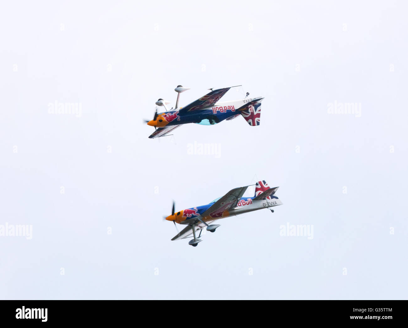 The Red Bull Aerobatic team flying at the American Airshow, Imperial War Museum, Duxford, UK - Stock Image