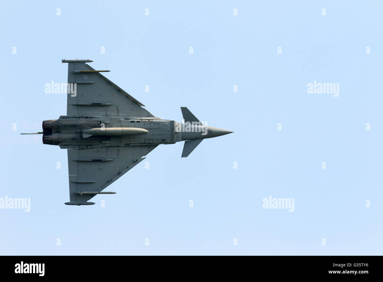 An RAF Eurofighter Typhoon FGR4 aircraft in flight, view from below, Duxford airport, Cambridge UK - Stock Image