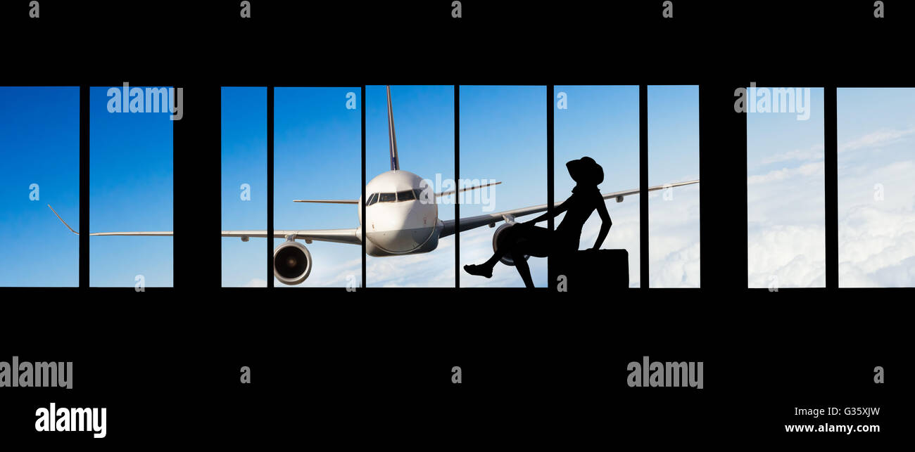 Young woman silhouette at Airport with suitcase. Big passengers plane on background. Travel concept of air transportation - Stock Image