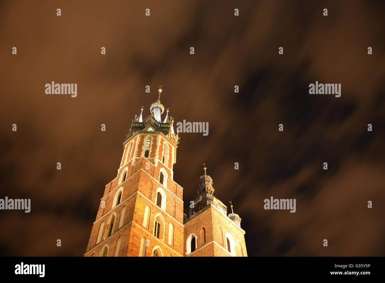 Krakow's famous St. Mary Basilica in Krakow at night (St. Mary's) Stock Photo