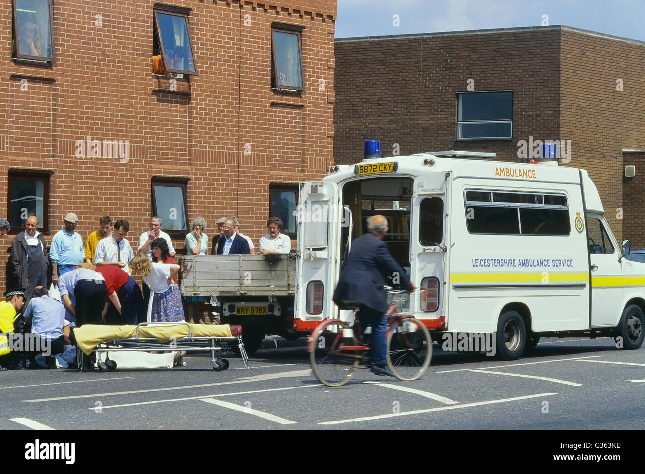Ambulance crew attend to an accident in Leicester. England. UK. Circa 1980's - Stock Image