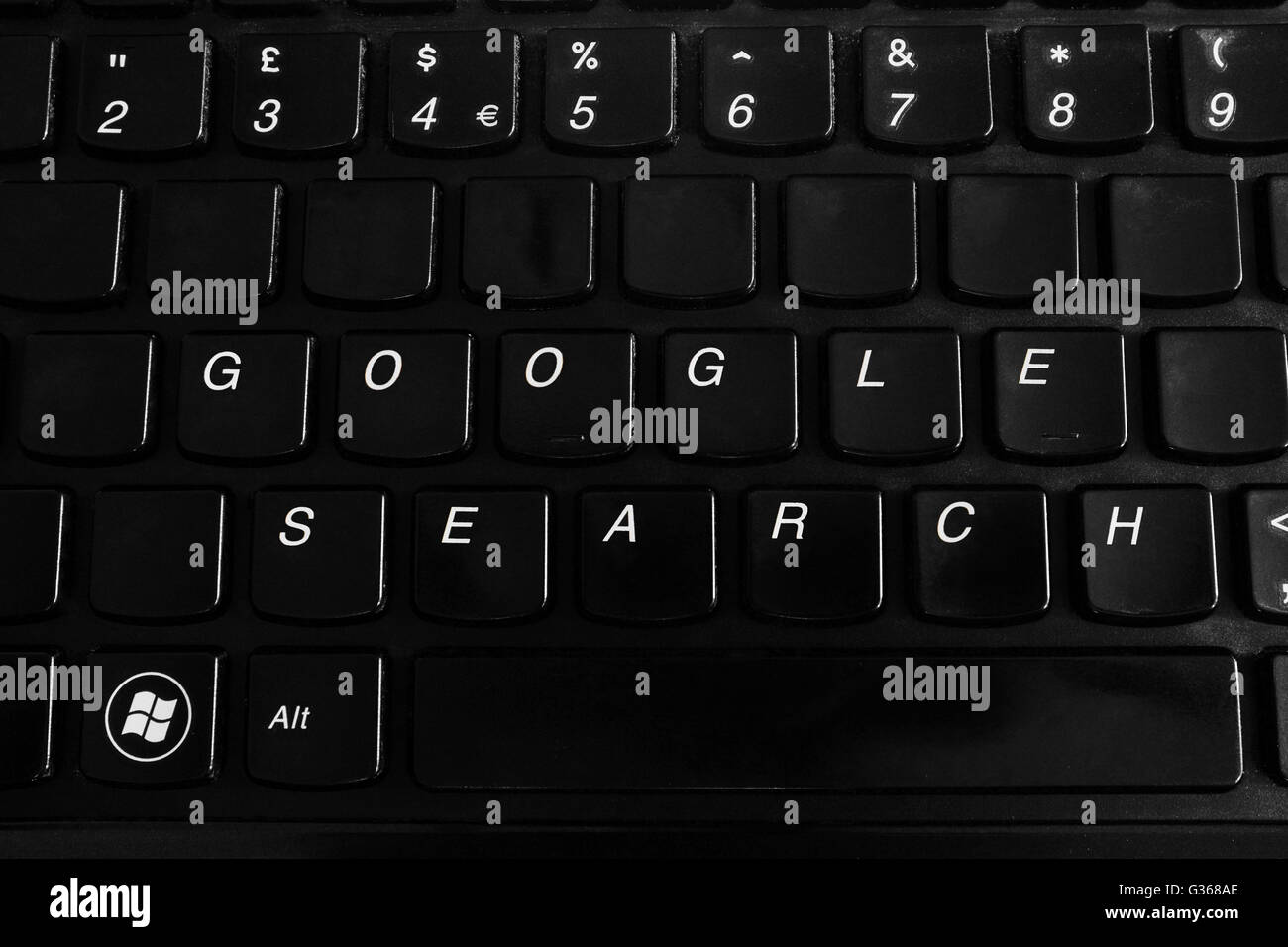 A black laptop keyboard with Google search on it. - Stock Image