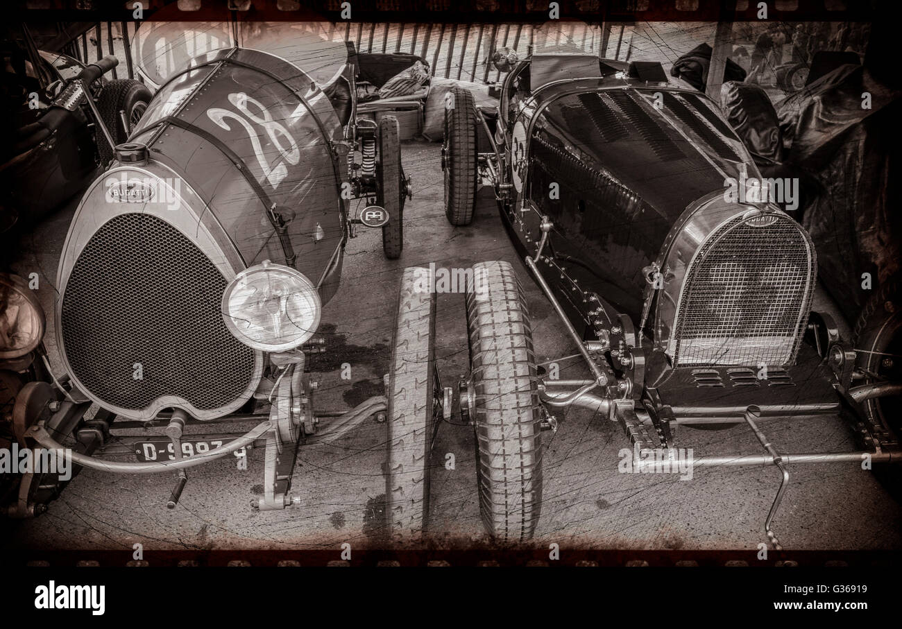 Two classic pre-war Bugatti GP cars in the paddock at the 2015 Goodwood Revival, Sussex, UK. Toned and textured - Stock Image