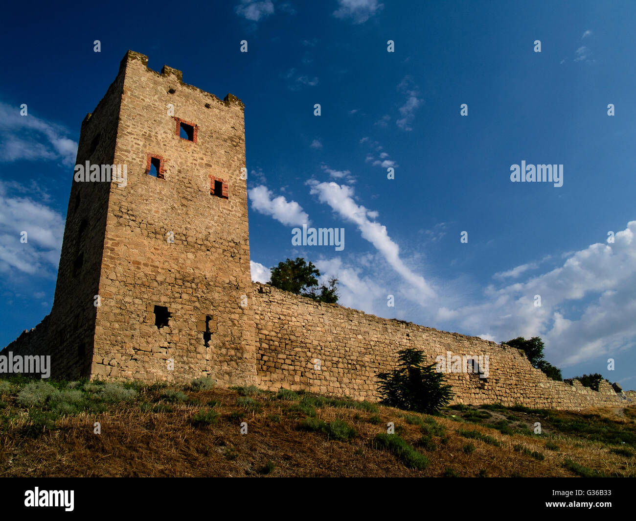 An old watch tower in the south of the hot summer - Stock Image