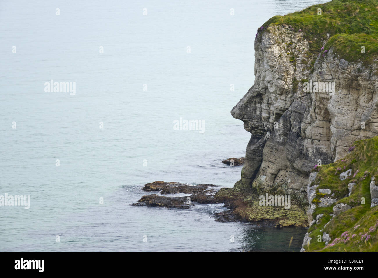 shape of mans nose in cliff  whiterocks cliffs - Stock Image
