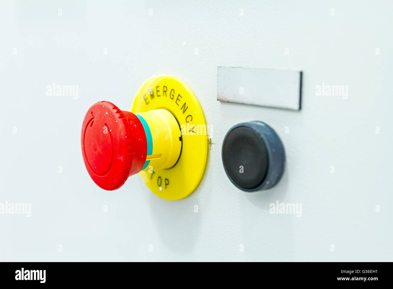 Emergency stop buttons must be obvious to see and simple to operate - Stock Image