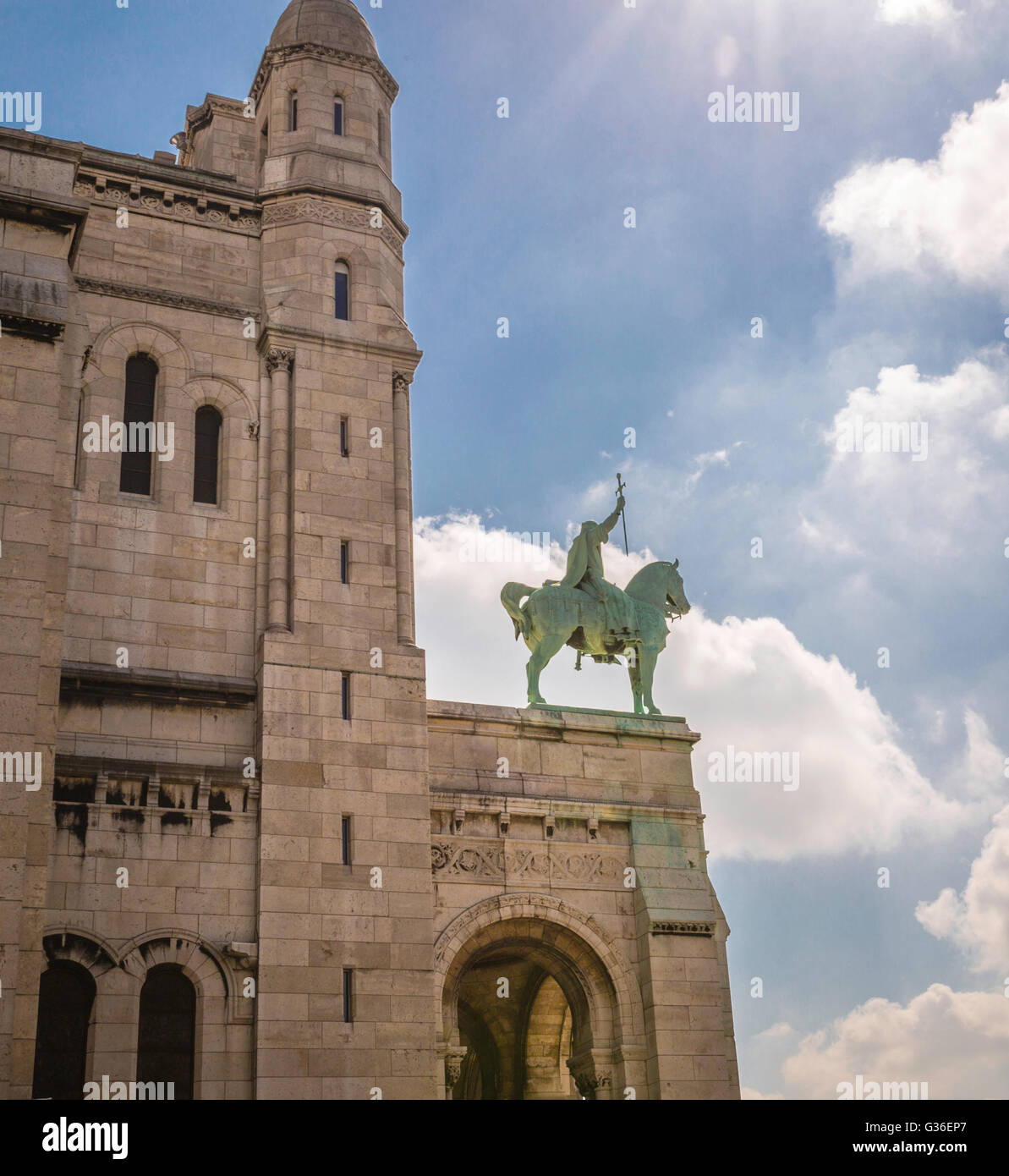 Equestrian statue of King Saint Louis with a sword over the entrance to Basilique du Sacre-Coeur, Paris Stock Photo