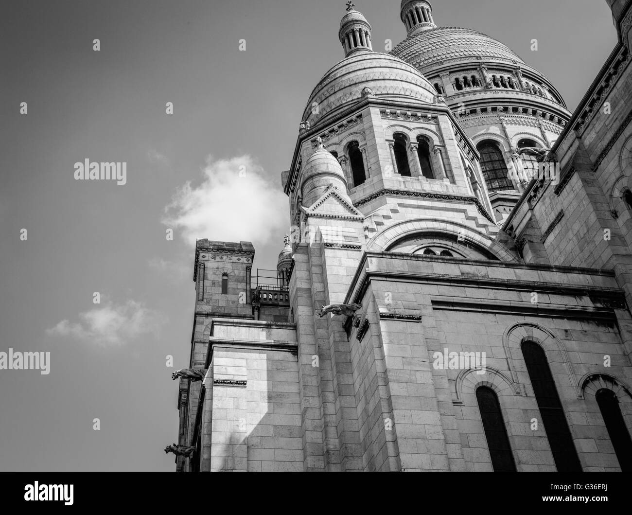 Sacre-Coeur Basilica in Paris is a major tourist attraction with its huge rounded domes and beautifully detailedStock Photo