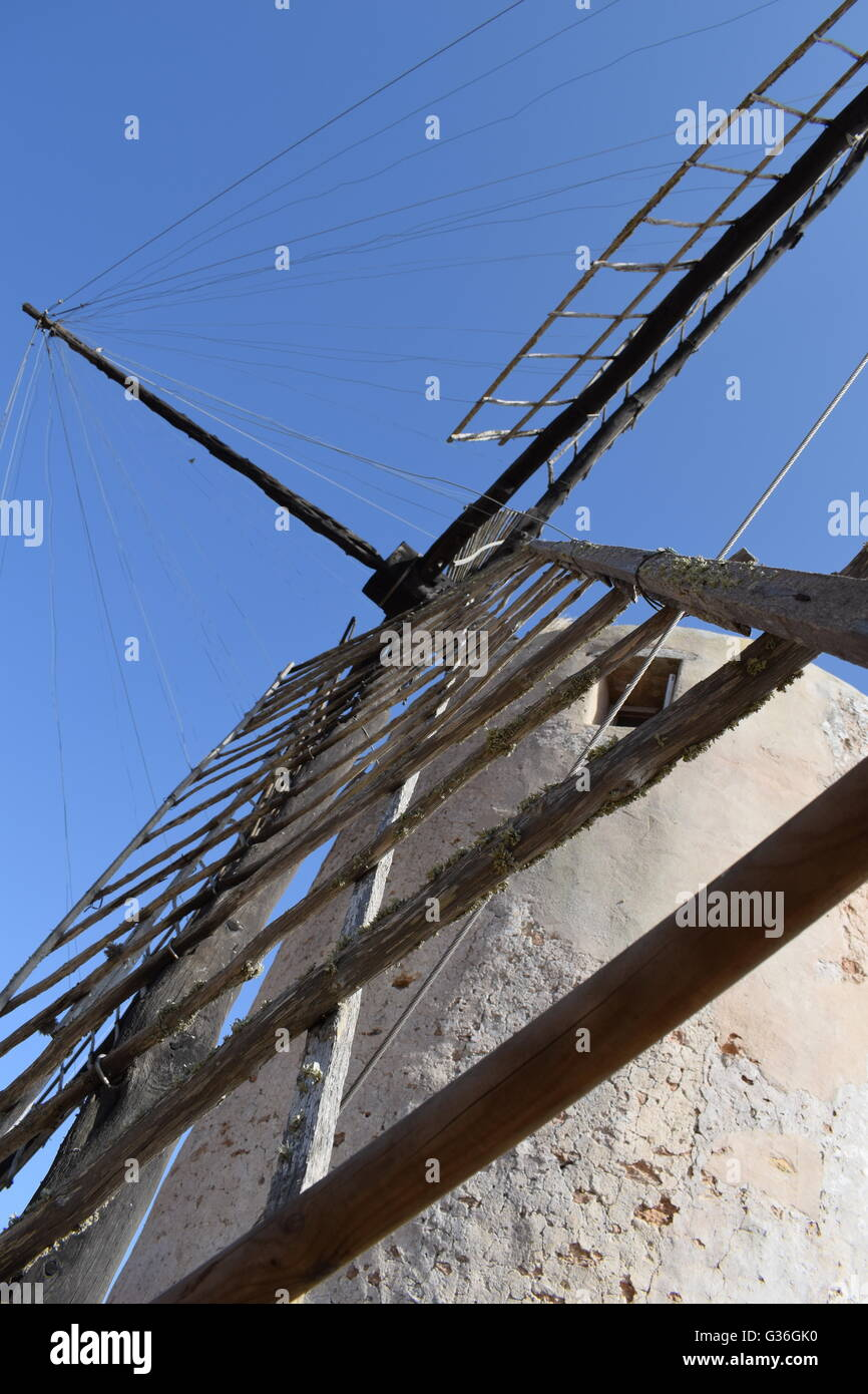 Low angle view along the sails of the Moli Vell de la Mola, windmill in Pilar de la Mola, Formentera, Balearic Islands, - Stock Image