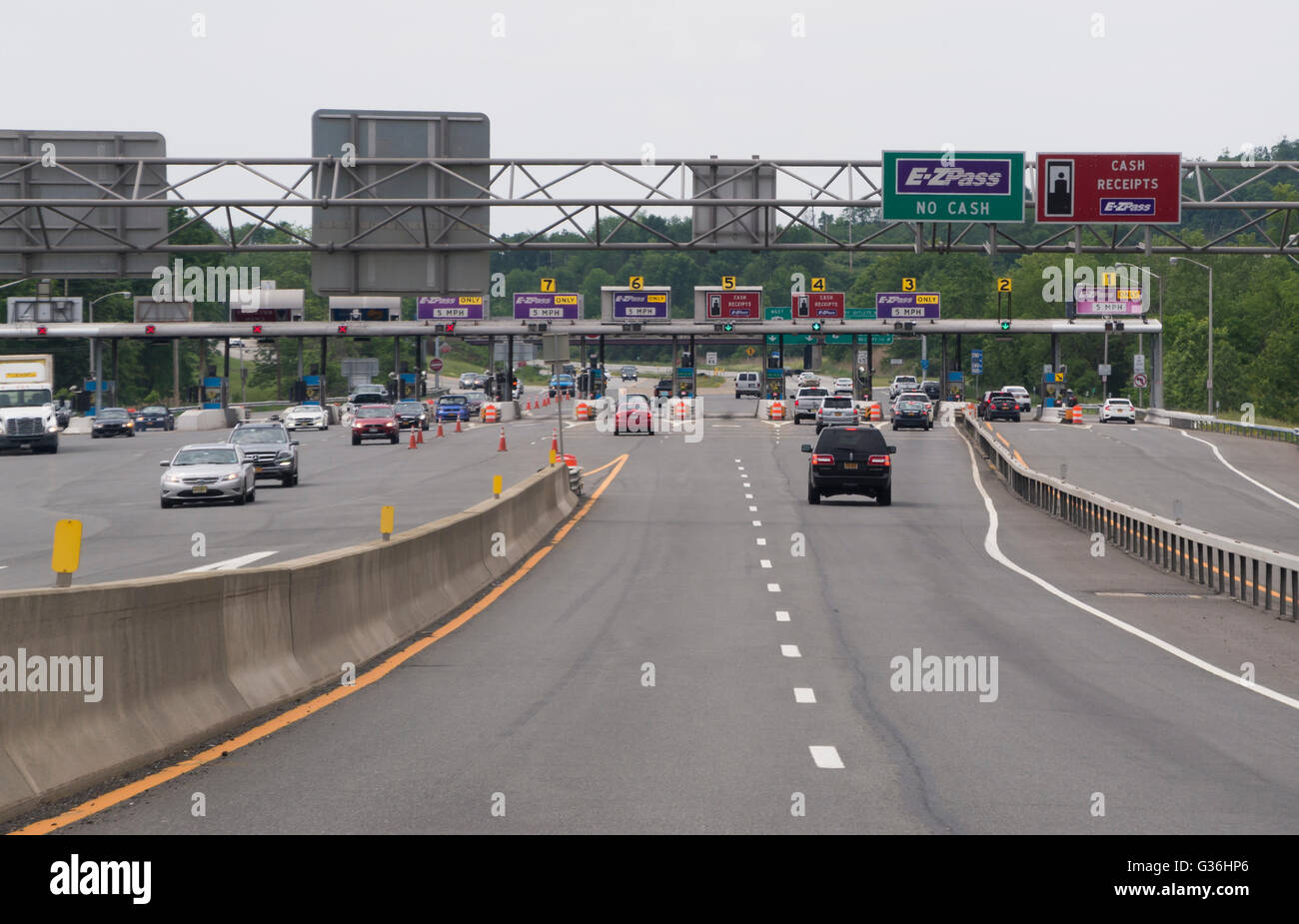 Highway approach to toll booths on the New York State Thruway, USA - Stock Image