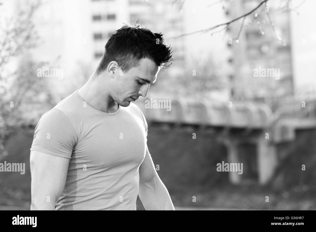 portrait of Recreational ruLifestyle portrait sporty man training in the city, workout, fitness, sport - concept - Stock Image