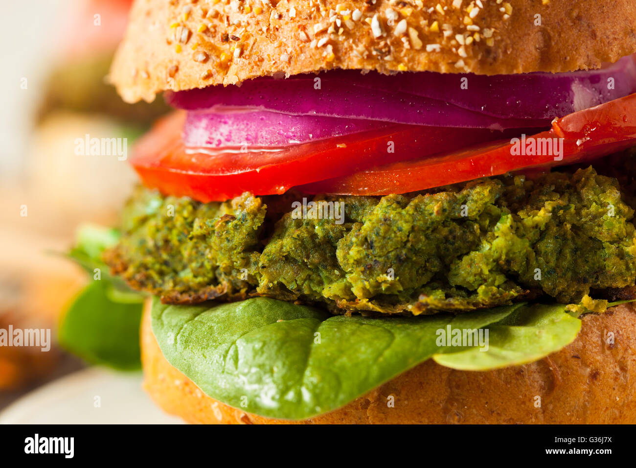 Homemade Green Vegan Burgers with Lettuce and Tomato - Stock Image