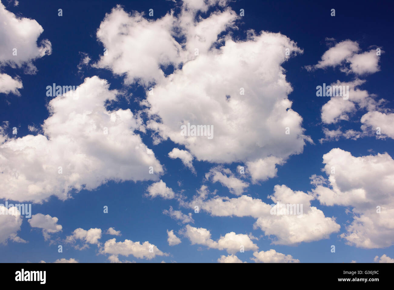 cumulus clouds at blue summer sky - Stock Image