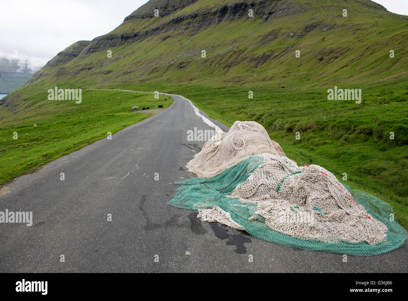 Fisher nets drying on a street on Eysturoy on the Faroe Islands - Stock Image
