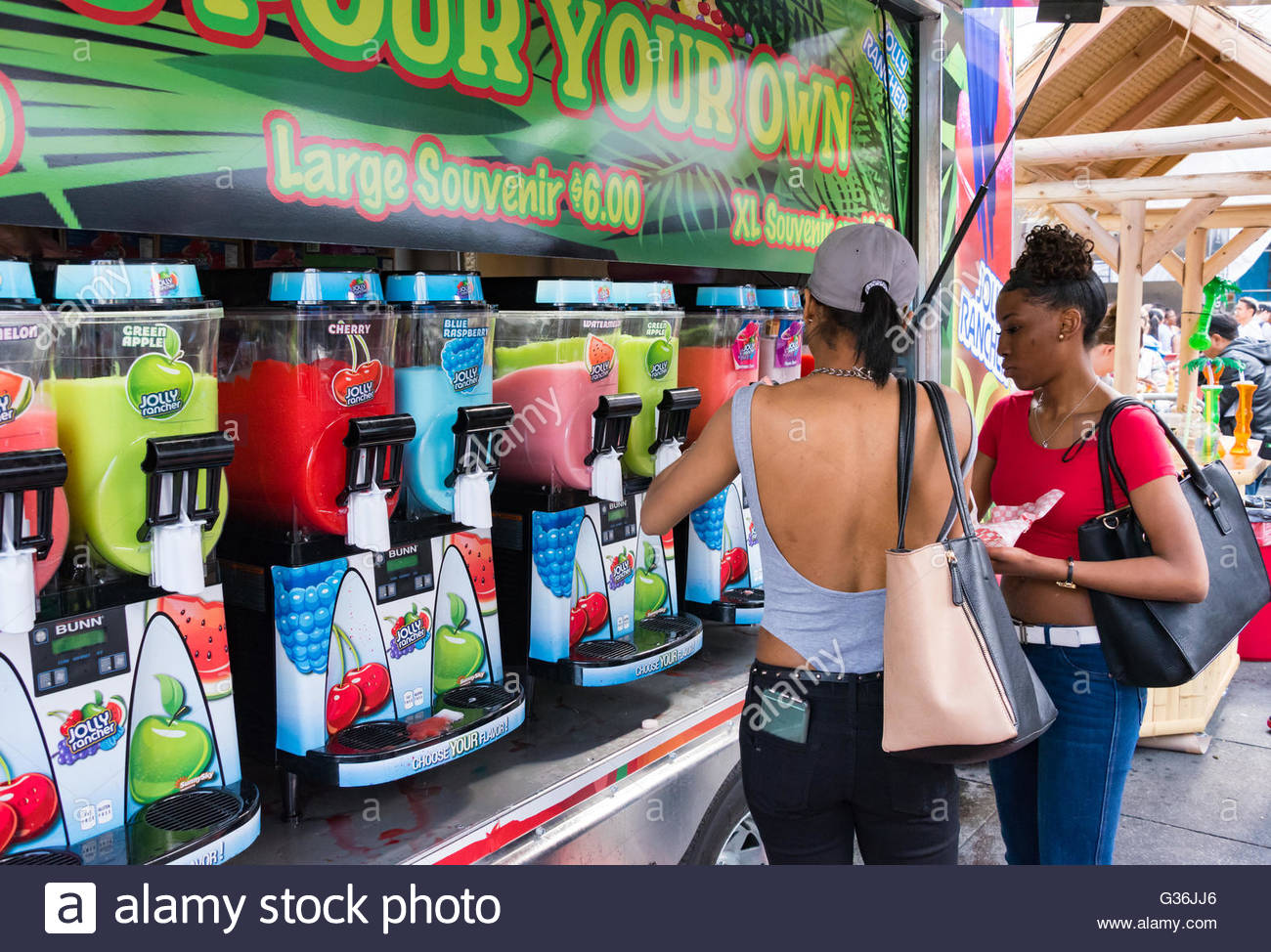 Food trucks selling frozen smoothies in festival. Regulations for food trucks has eased while the city looks for - Stock Image