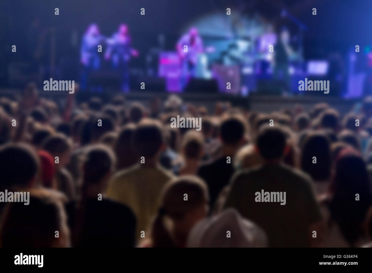 Defocused crowd and performers on music festival - Stock Image