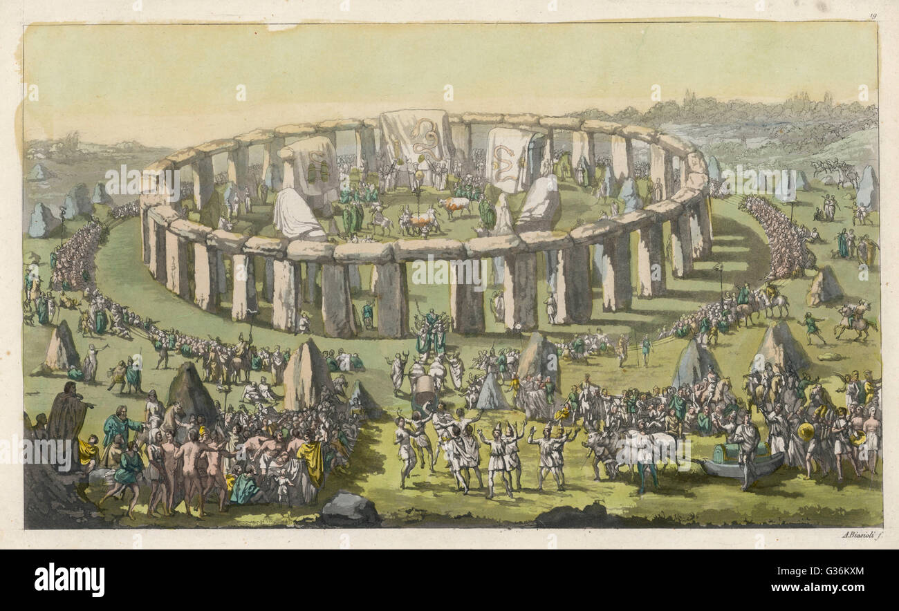 Celebrating a grand  conventional festival at Stonehenge : priests and bards perform their functions, oxen drag - Stock Image