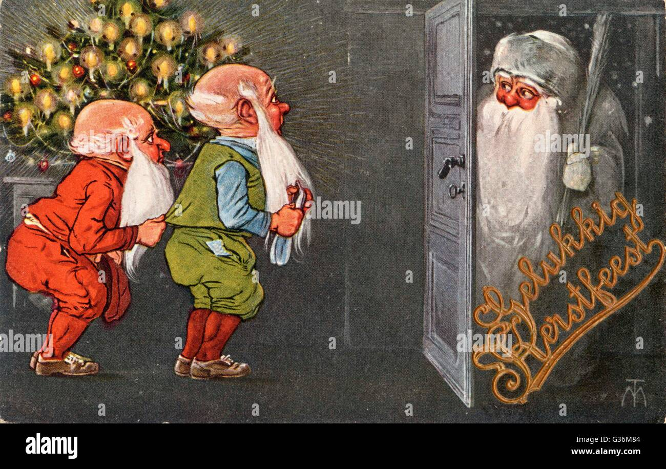 Father Christmas visits the  gnomes - Stock Image
