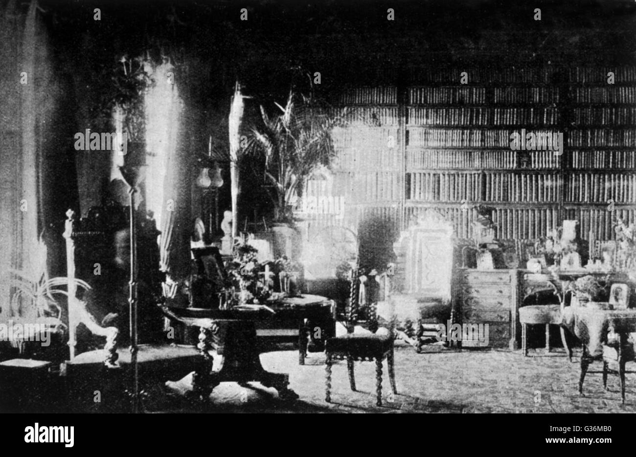 Sybell Corbet's photograph of  the library at Combermere,  taken between 2-3 pm, seeming  to show a figure, resembling Stock Photo