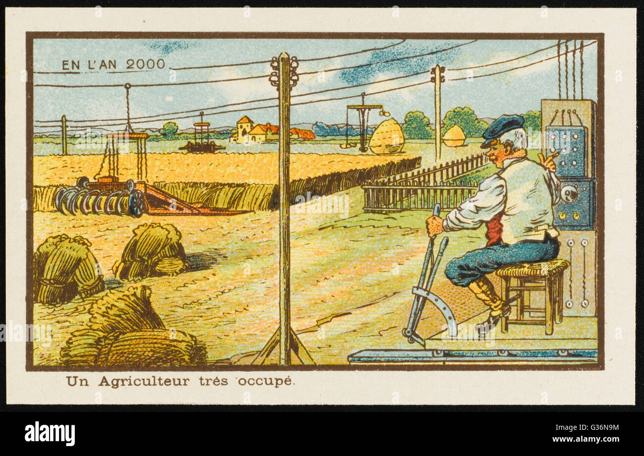 An example of futuristic farming, the automated way.  The farmer sits on a chair and operates the controls, while - Stock Image