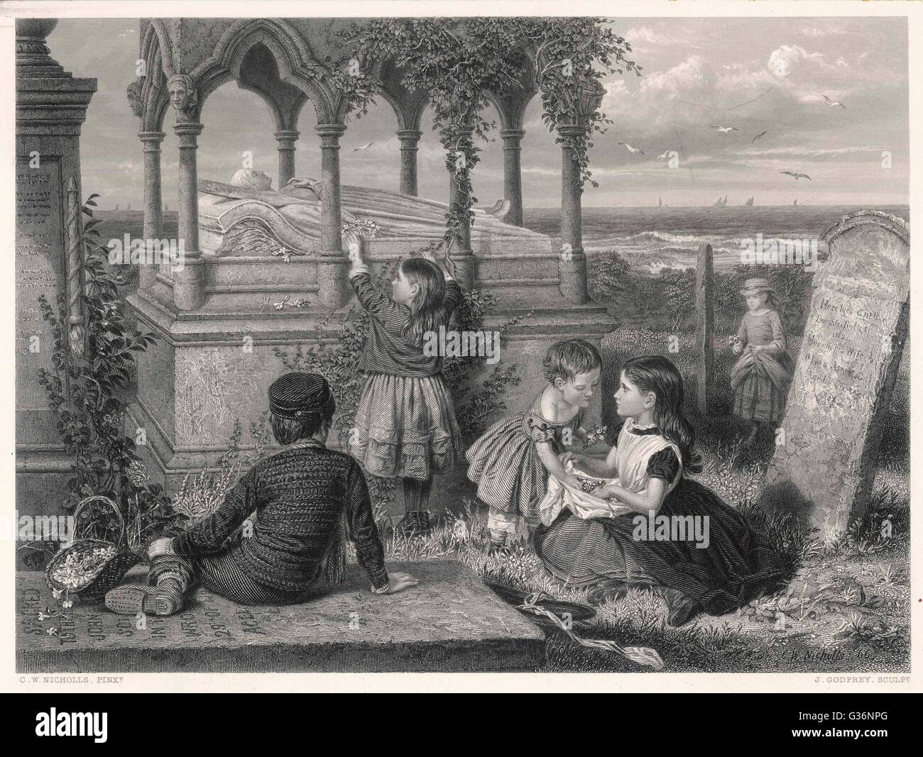 Children at the tomb of Grace Horsley Darling (1815-1842), in St. Aidans churchyard, Bamburgh, Northumberland.  She was the daughter of the Farne Islands lighthouse keeper, William Darling.  She rowed with her father to the sinking steamboat the SS Forfar Stock Photo