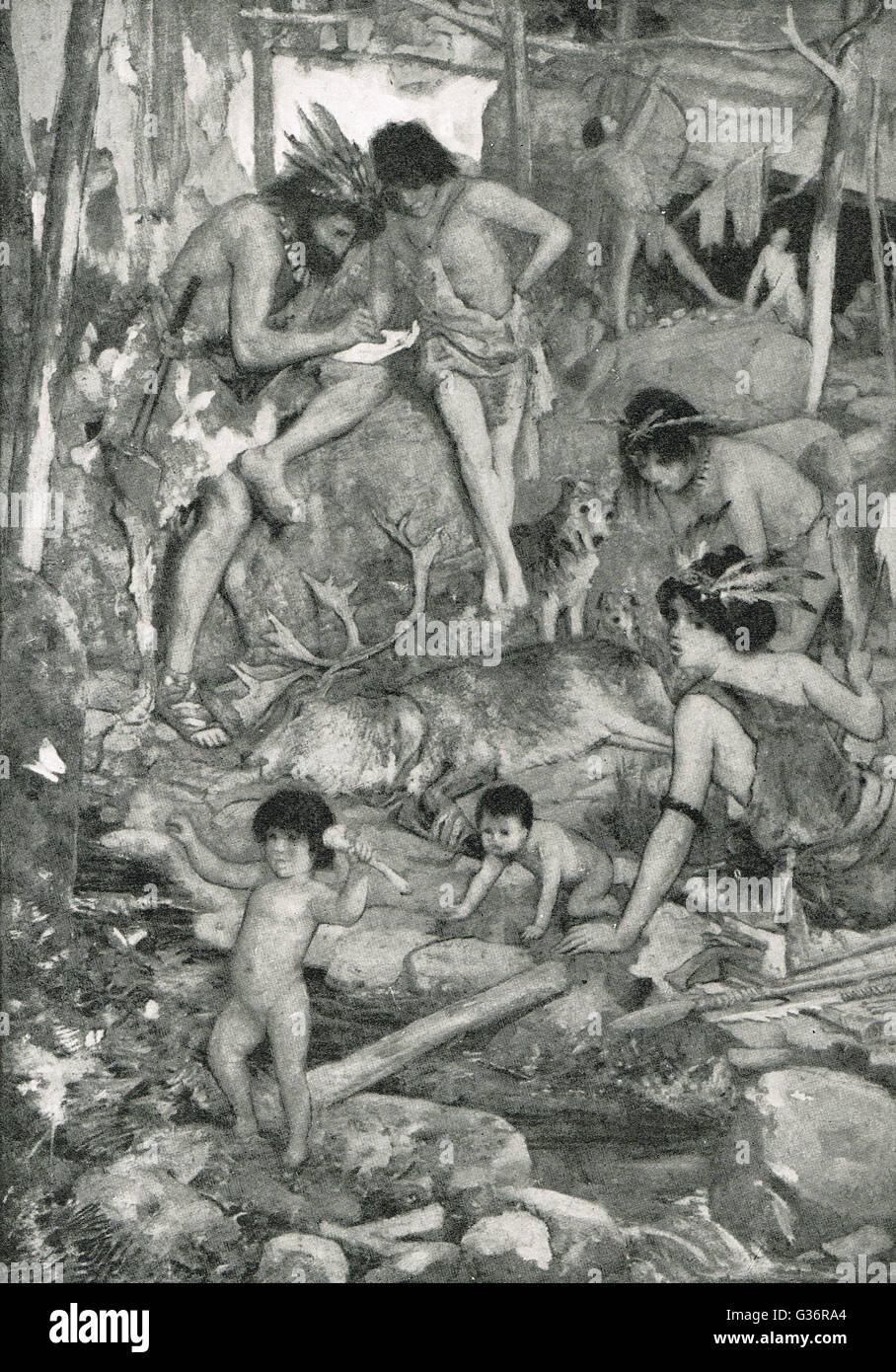 Prehistoric Cave People with Deer Kill - Stock Image
