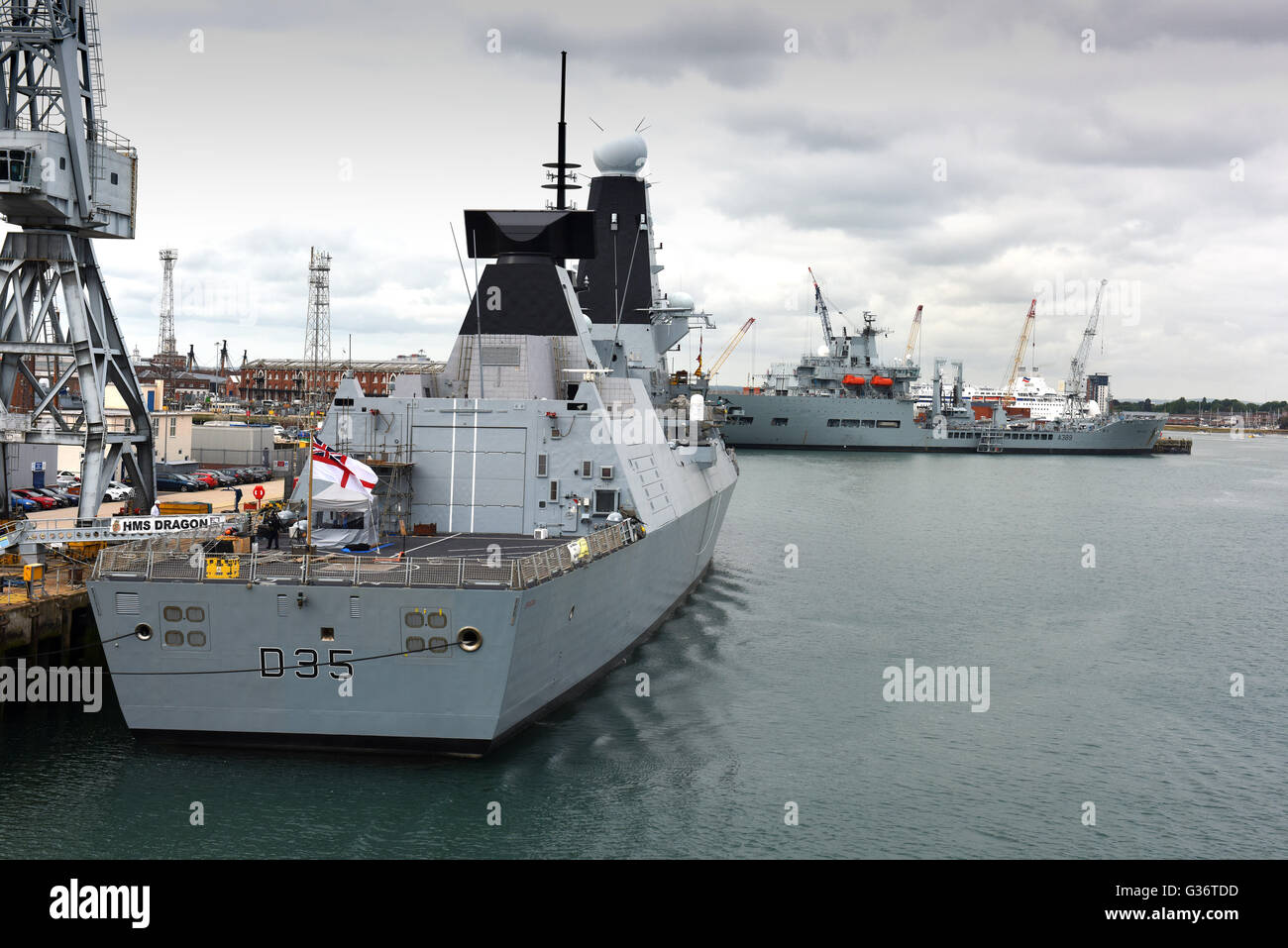 HMS Dragon D35 a Royal Navy Type 45 air defence destroyer at Portsmouth Naval Base harbour in Hampshire England - Stock Image