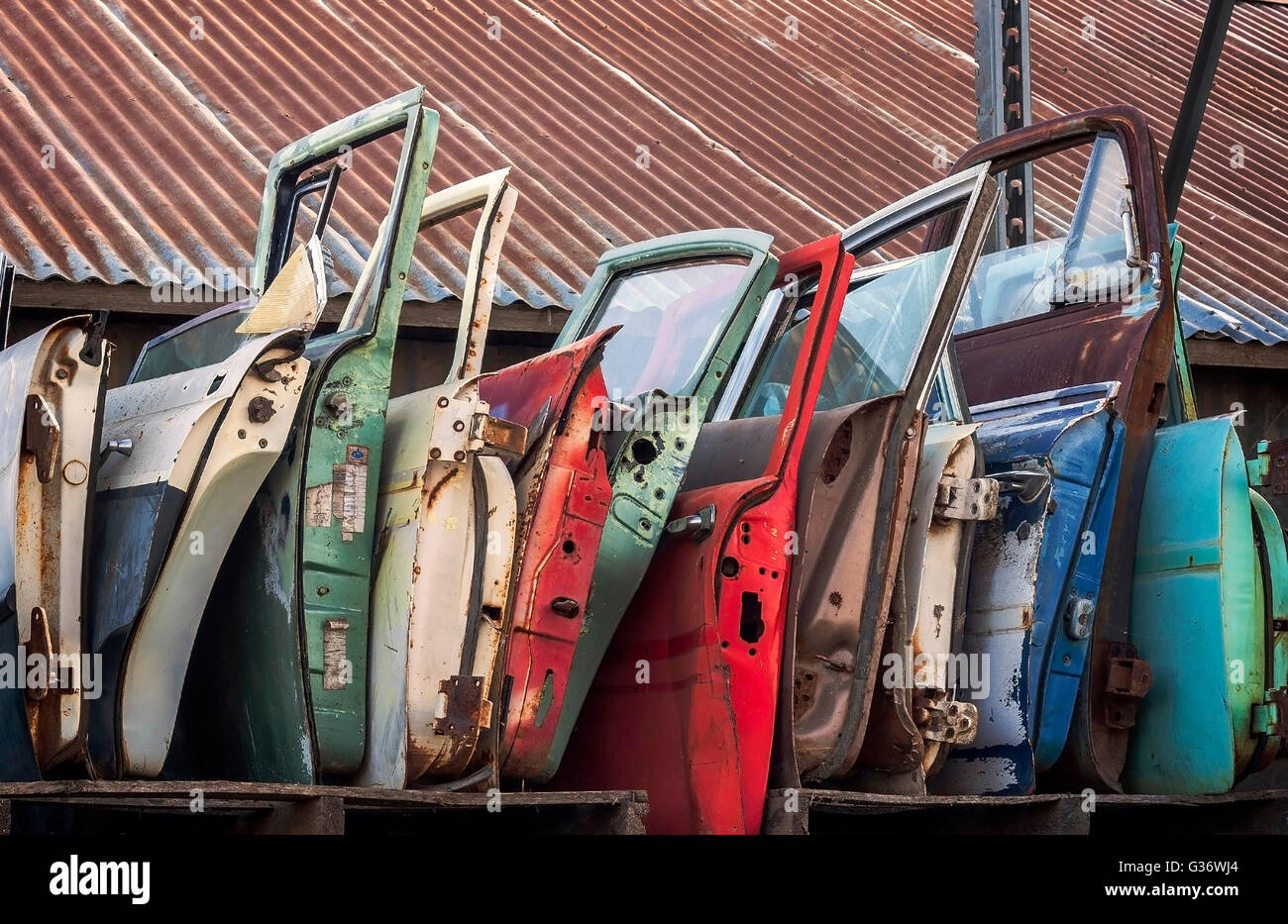 Junk Yard card doors waiting to be sold to an interested buyer. - Stock Image