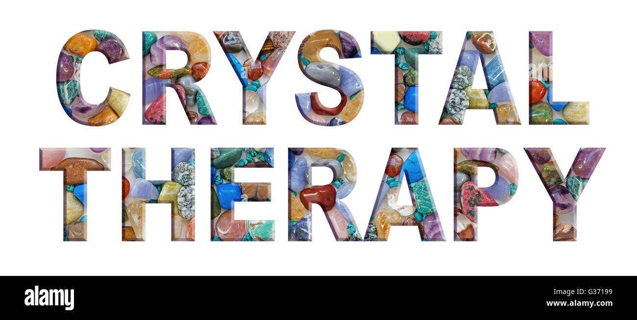 The words CRYSTAL THERAPY made up from a background alphabet of multicolored, tumbled crystal stones - Stock Image