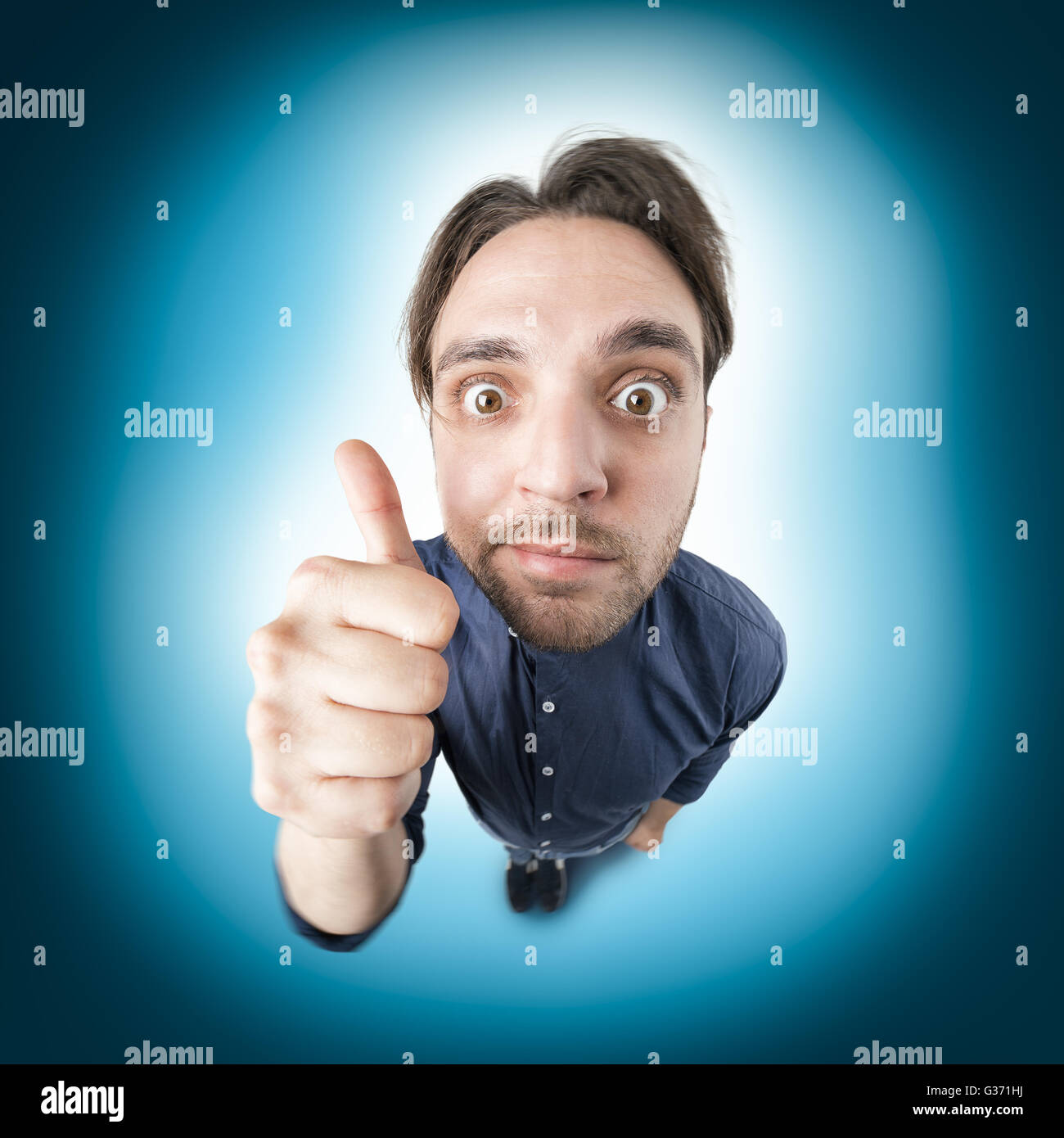 Funny nerd man say ok with thumb up and crazy hair style - Stock Image