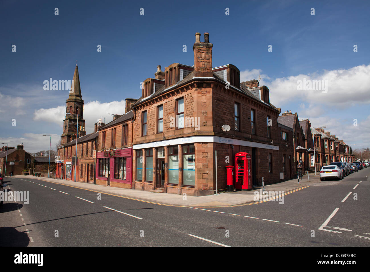The red sandstone architecture of a Scottish Border town, Annan, complete with old style British telephone and letter - Stock Image