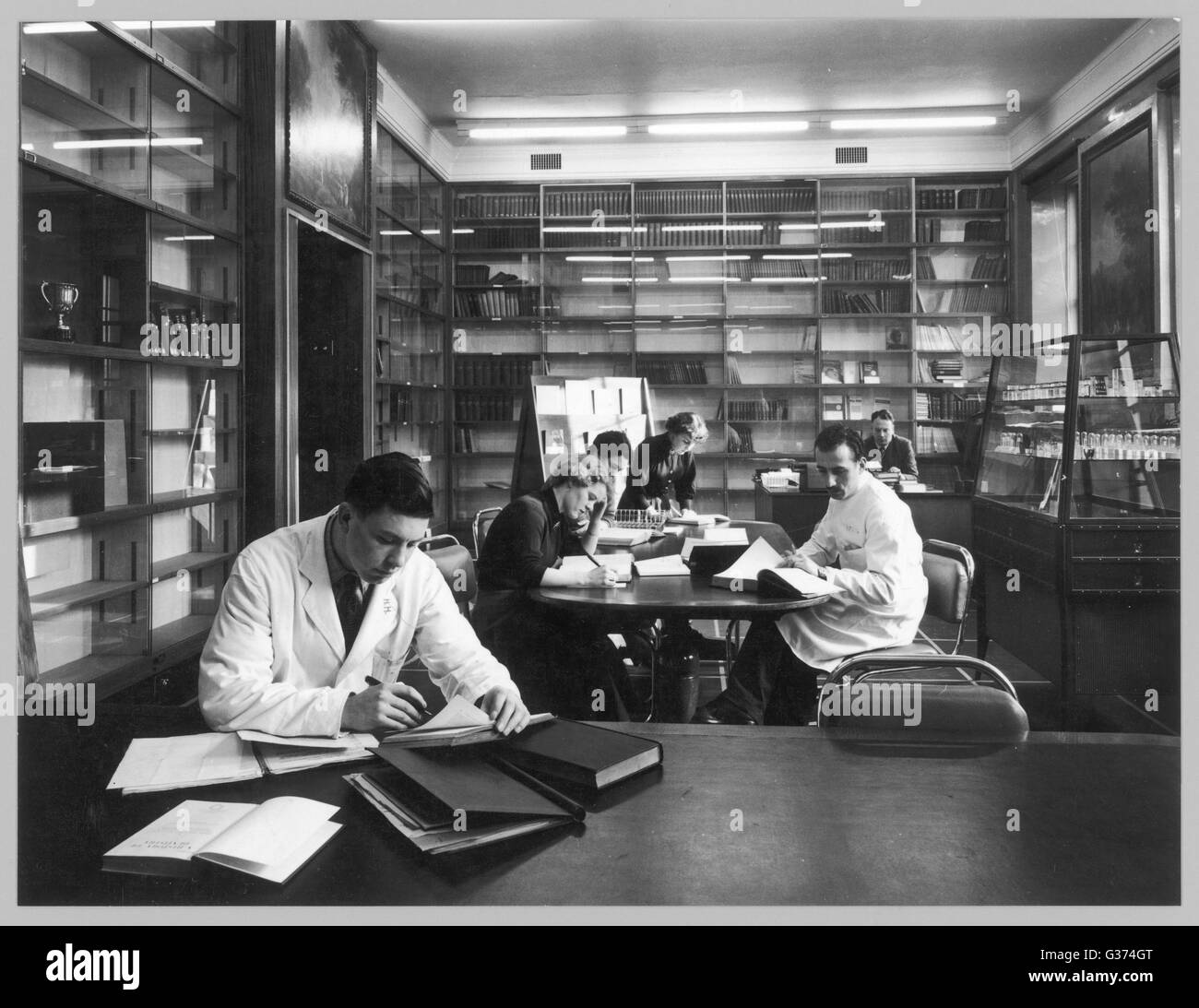 Students at Edinburgh  University, apparently  studying science, read and  make notes in a library      Date: 1950s - Stock Image