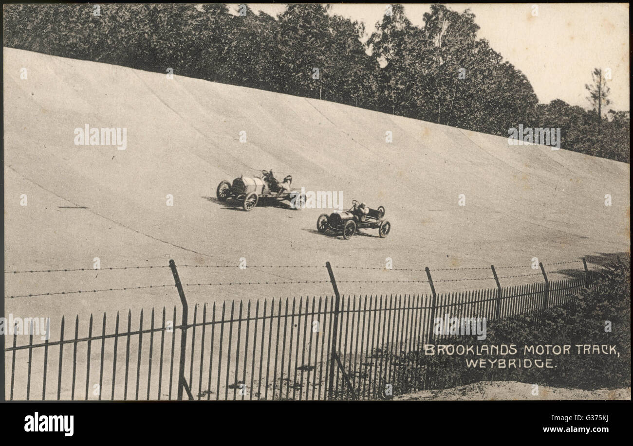 Two racing cars compete on the  new circuit at Brooklands,  near Weybridge, Surrey,  designed for the testing of - Stock Image