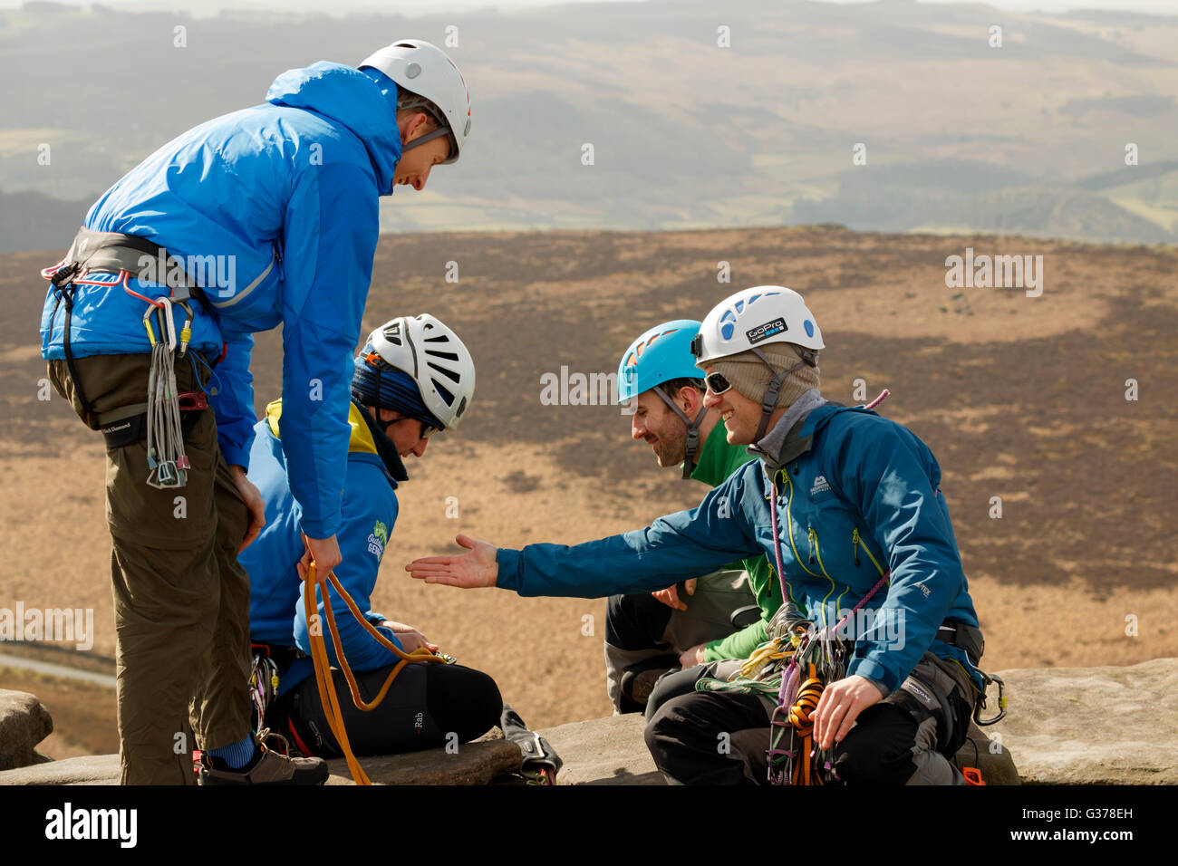 Group of rock climbers with ropes and safety gear in the Peak District Derbyshire England Stock Photo