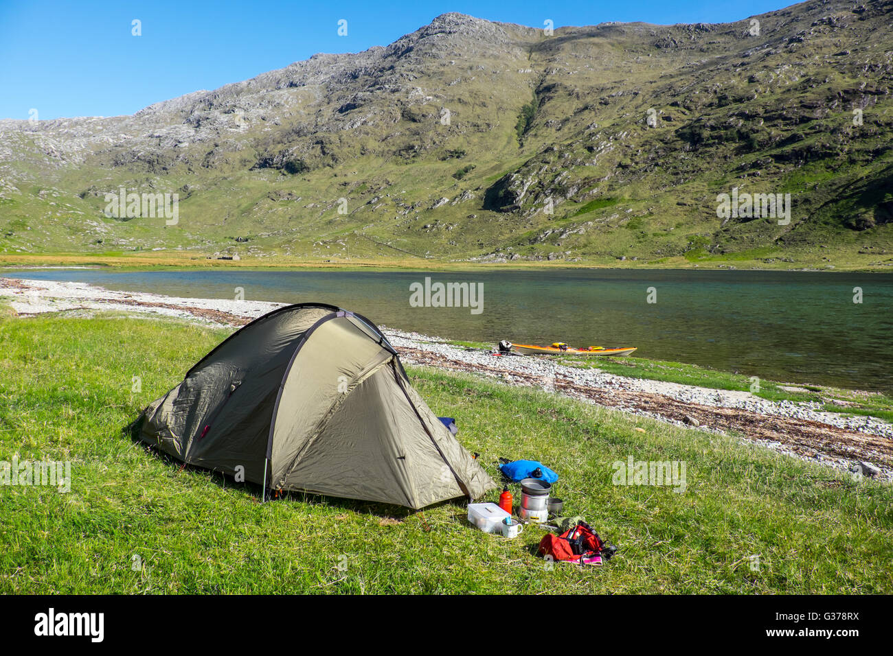Wild camping at the head of Loch Nevis, Knoydart, Scotland as part of a sea kayaking expeditio - Stock Image