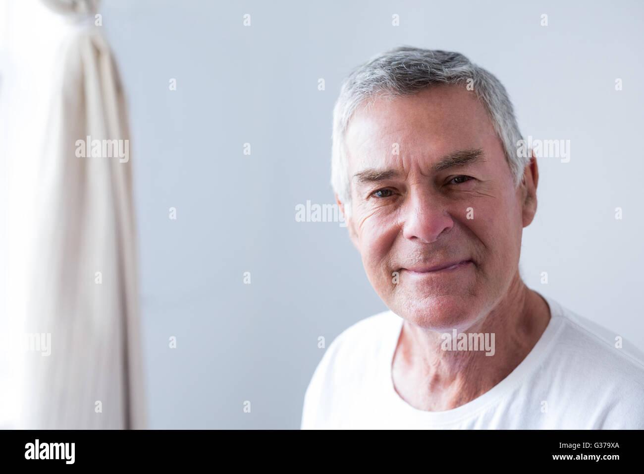 Portrait of senior man smiling - Stock Image