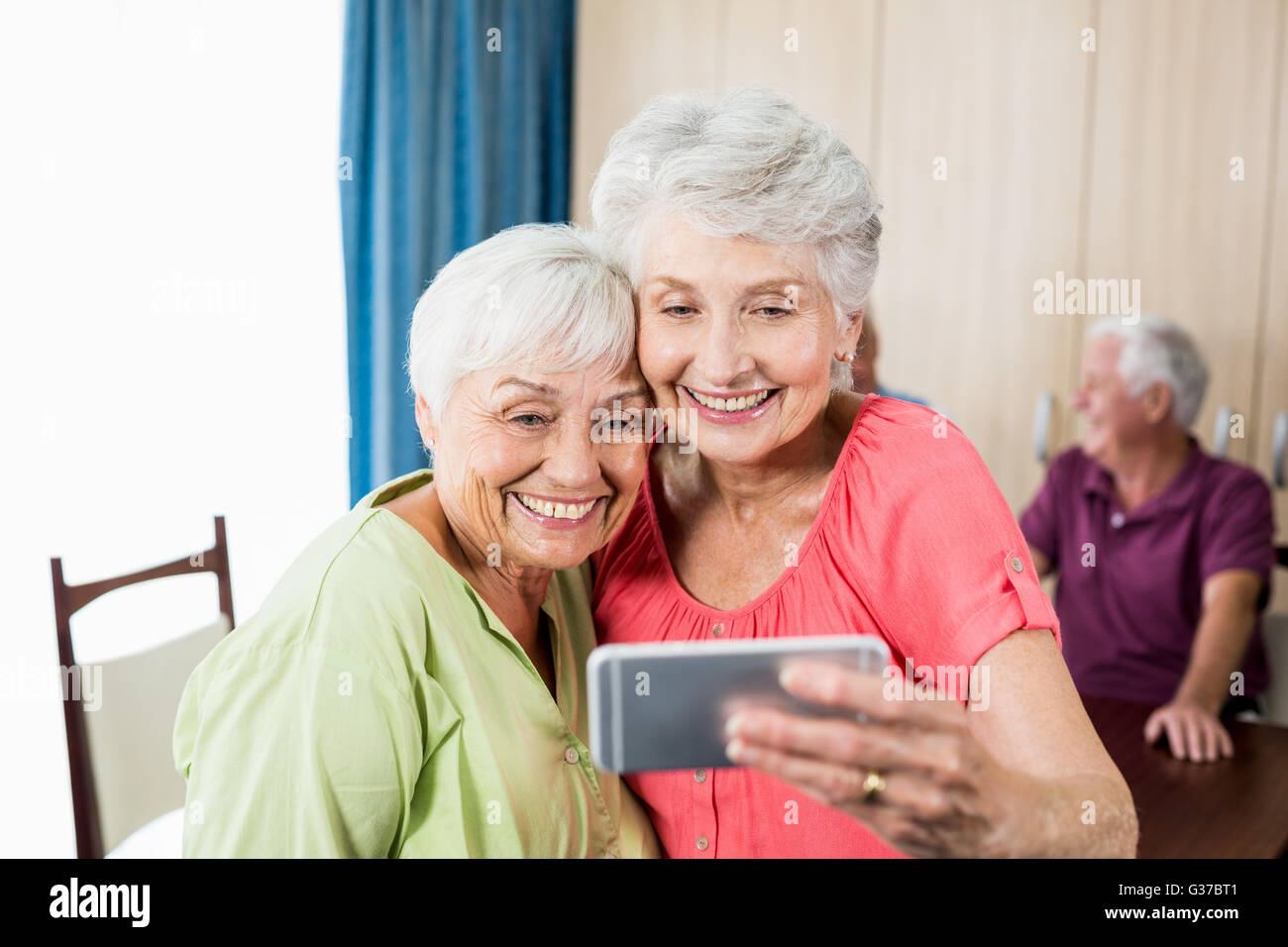 Senior women taking a selfie - Stock Image