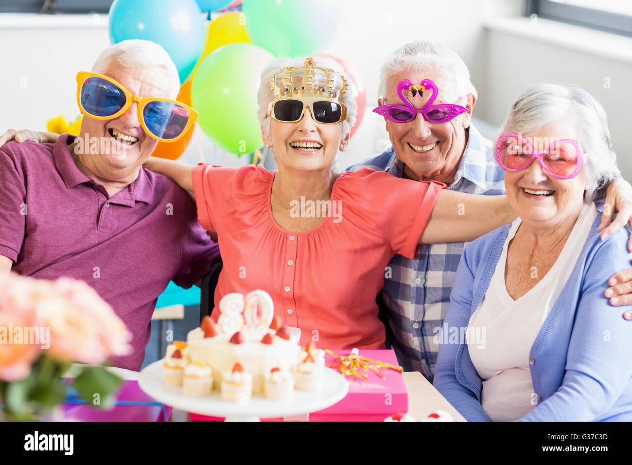 Seniors wearing funny glasses - Stock Image