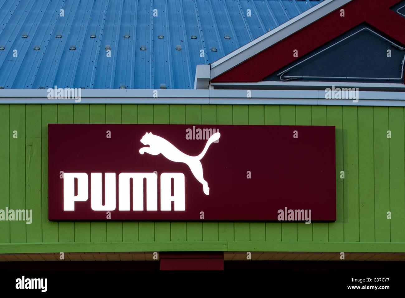 Oshkosh, WI - 5 June 2016: Puma store sign illuminated at night - Stock Image